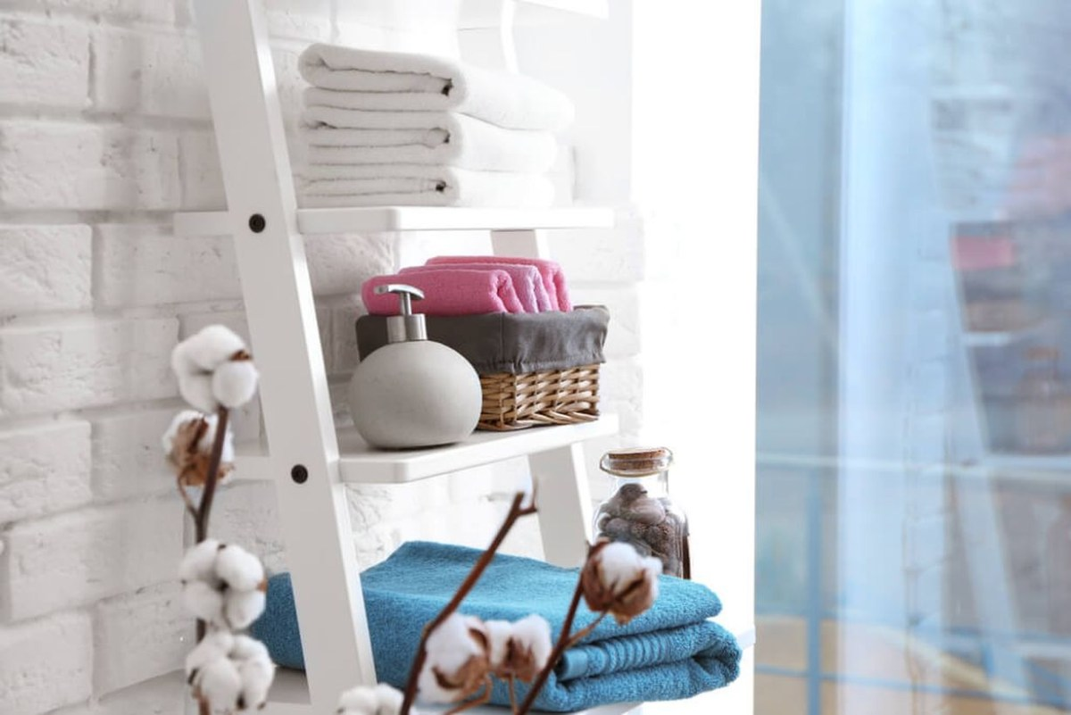 Creative storage bathroom with a white ladder to store toiletries