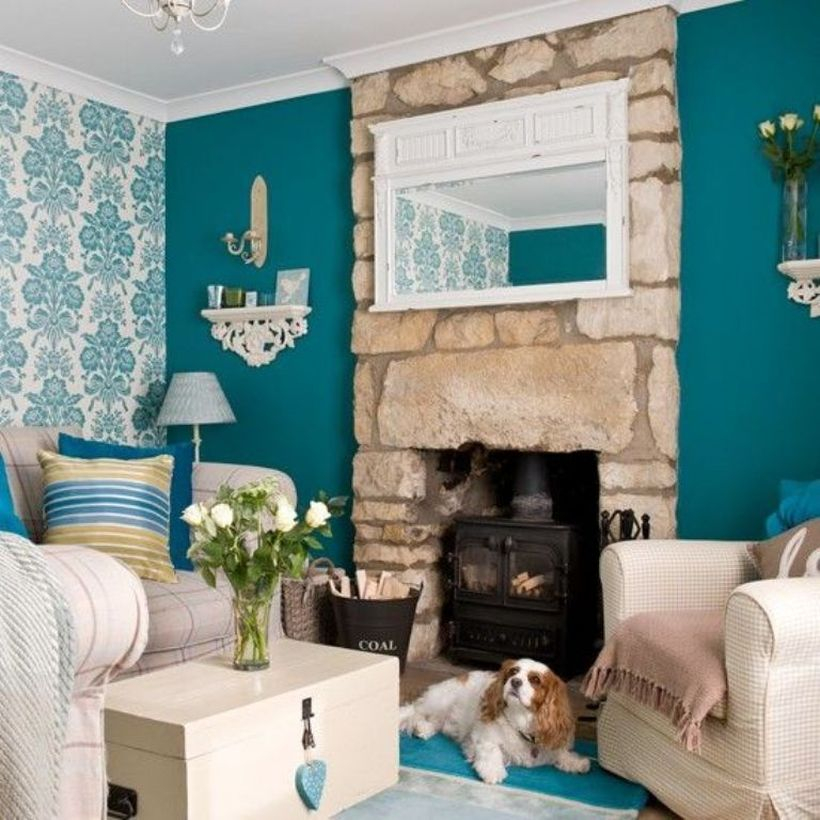 A comfortable home paint colors with green tosca on one of the living room walls that you have can you combine with light blue patterned wallpaper
