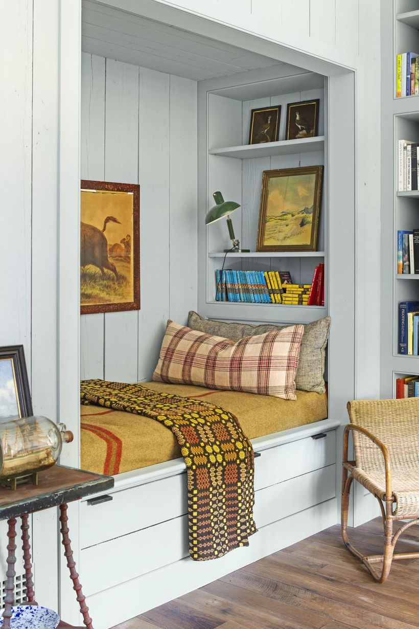 A wonderful indoor redecoration from summer to fall with plaids and stripes, this reading nook's subtle pops of cinnamon this to be the most popular indoor hangout spot of the season.