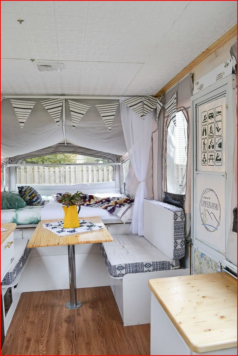 Amazing rv decor with plants with yellow teapots and striped triangular paper