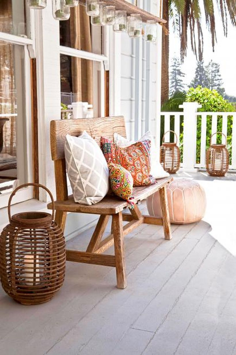 An awesome seating ideas with a wooden chair, candle lights from rattan and pillows