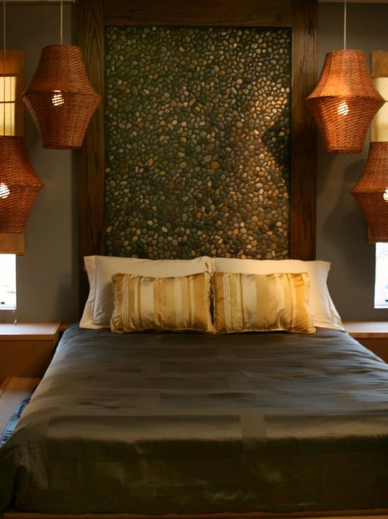 An amazing bedroom with stone headboard to bringing natural elements into your bedroom