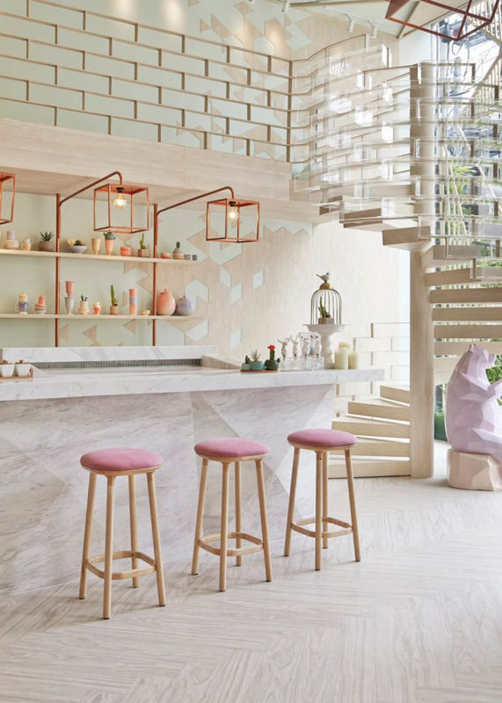 An amazing square copper lamps combined with bright walls to perfect your kitchen design
