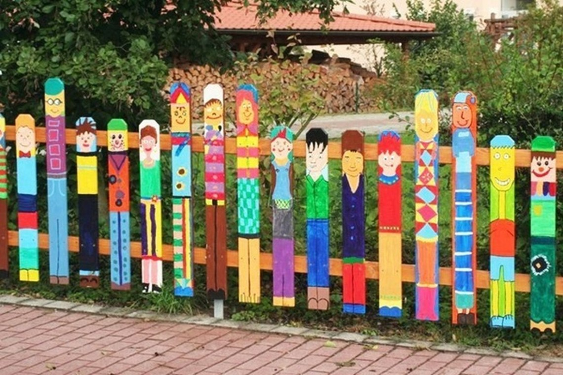 An attractive painting fence for garden with brightly coloured fence people made a whole range of fun looking individuals in all different painting styles.