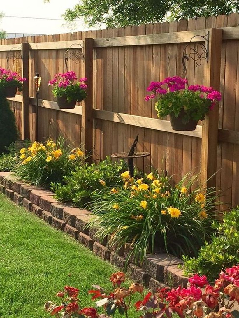 An attractive plant decoration for fence with hanging basket fence hanging baskets are relatively cheap and you can use them to really give your fence some life.