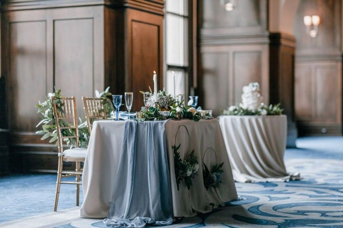 An awesome indoor table set for wedding with table runners, fairy lights are the perfect decoration for more rustic affairs and candles work well for vintage affairs.