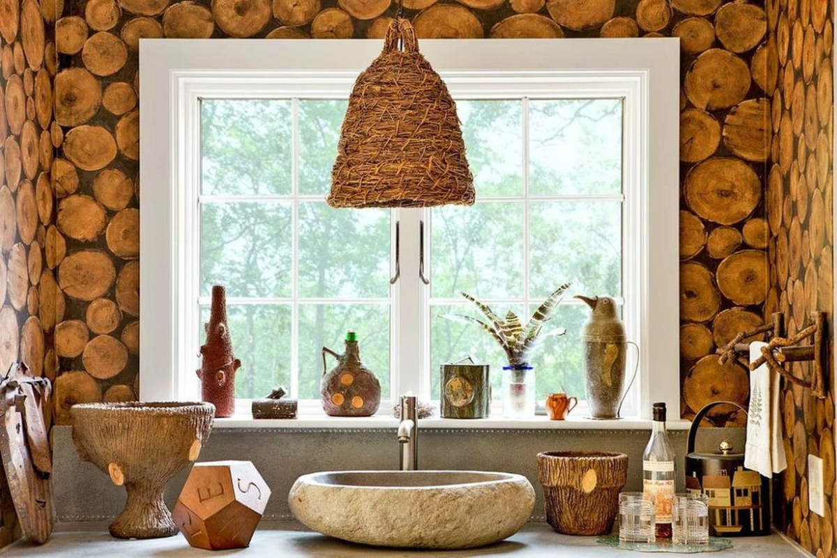 An elegant indoor redecoration from summer to fall with a light made from a vintage skep, river rock sink, small windows and wooden beam wallpaper