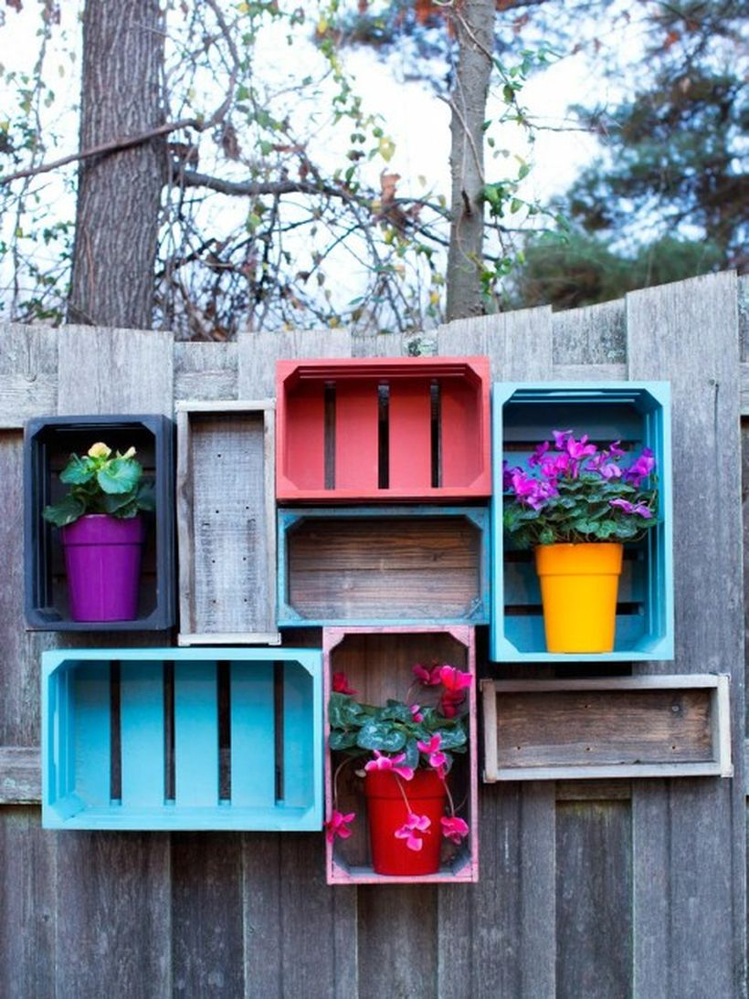An exciting plant decoration for fence with rustic wooden crate shelves add beauty to your backyard and have all that storage space tools or plants.