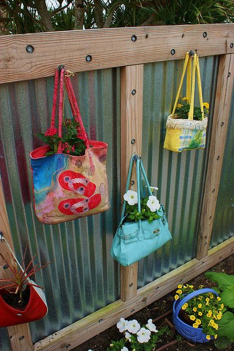 An incredible plant decoration for fence with colorful bag, totes lunch bags into beautiful planters for fence line the bags with plastic to keep soil from staining the fabric.