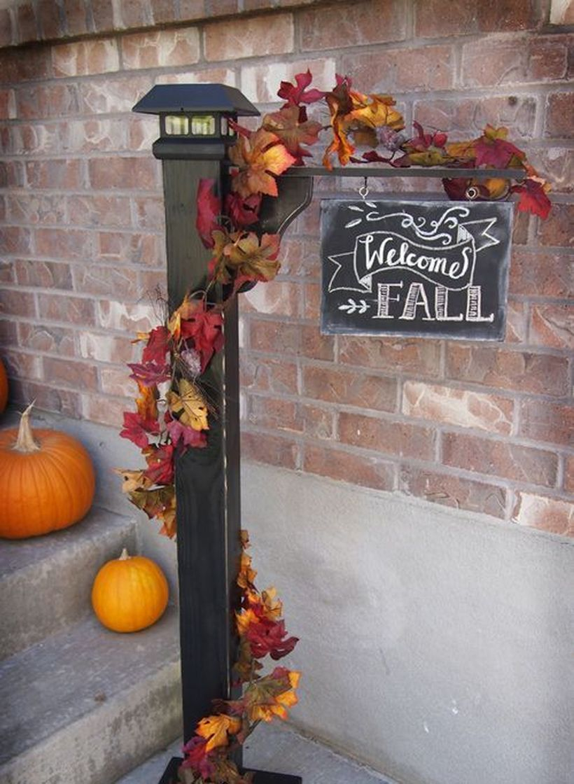 Beautiful porch ideas with hanging wooden fall welcome signs and small pumpkins