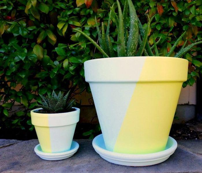 Creative clay pot design with two-toned painted pots to perfect your garden