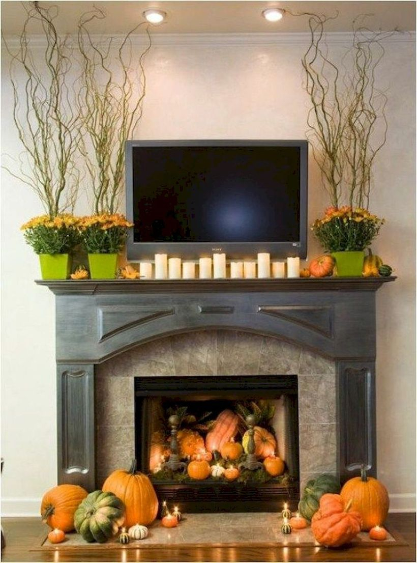 Orange pumpkin and candle light fireplace decoration