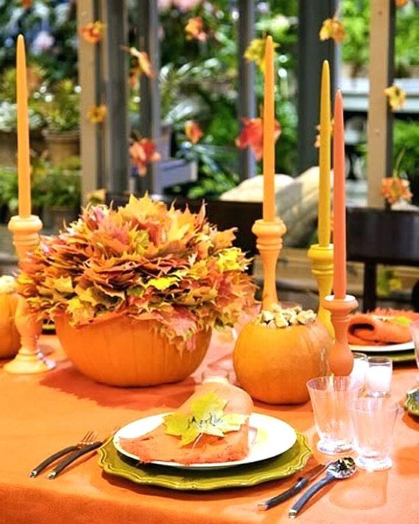 Orange pumpkin and dried leaves centrepiece ideas