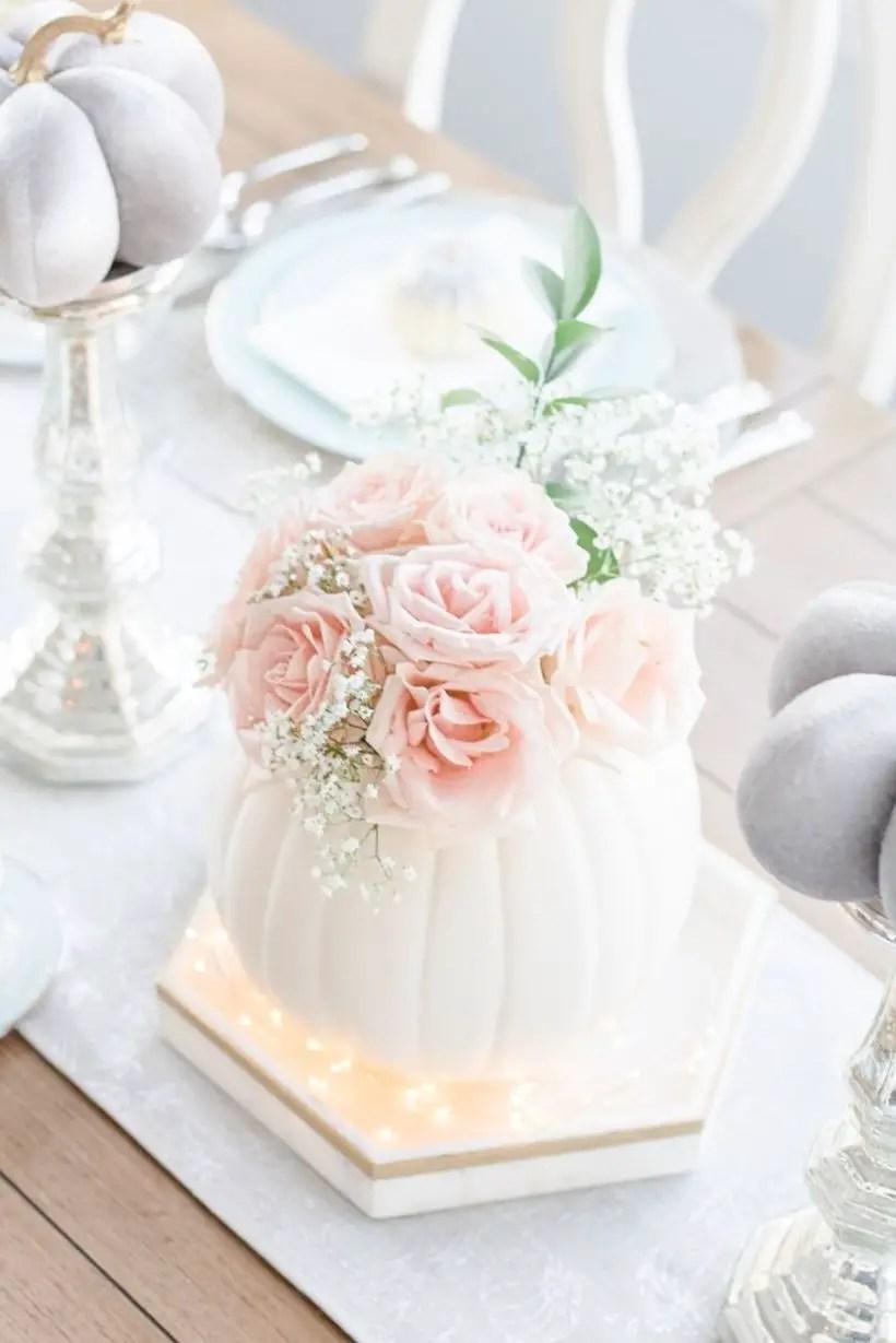 Pretty white pumpkin and pink flowers centrepiece ideas