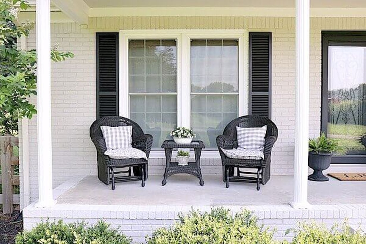 Simple-summer-farmhouse-porch-best farmhouse porch furniture with black rattan chairs and small square black table