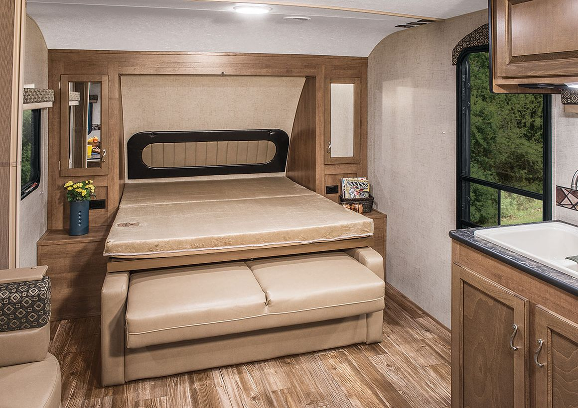 Simple murphy bed with beige color, beige sofa under the bed and wooden storage cabinet