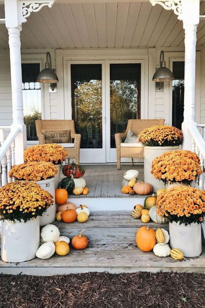 Use fresh flowers and lots of little gourds to beautify your front stair in this fall