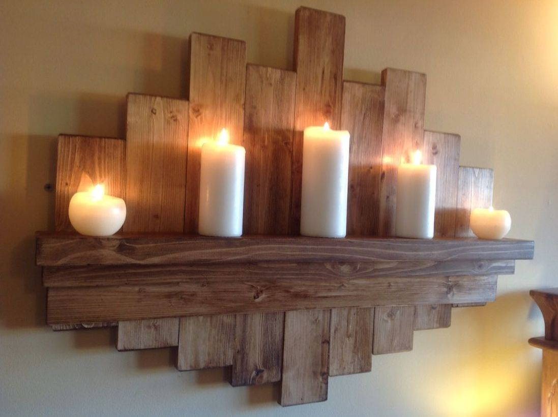 A creative rustic wall art ideas with hanging rack to store candles to create good lighting