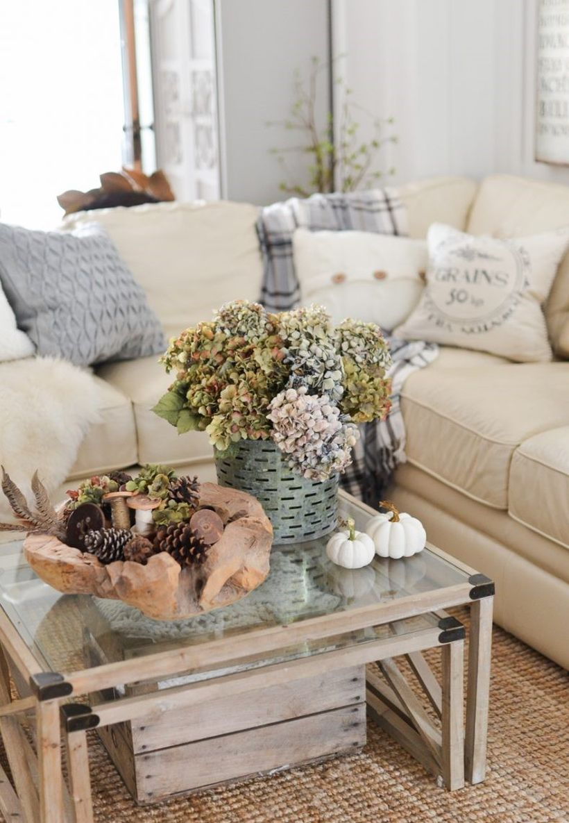 Farmhouse living room decoration with pumpkin decoration on table coffee and centerpiece, houseplant to complement your room