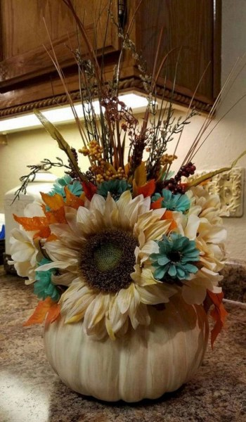 Flower arrangement using white pumpkins