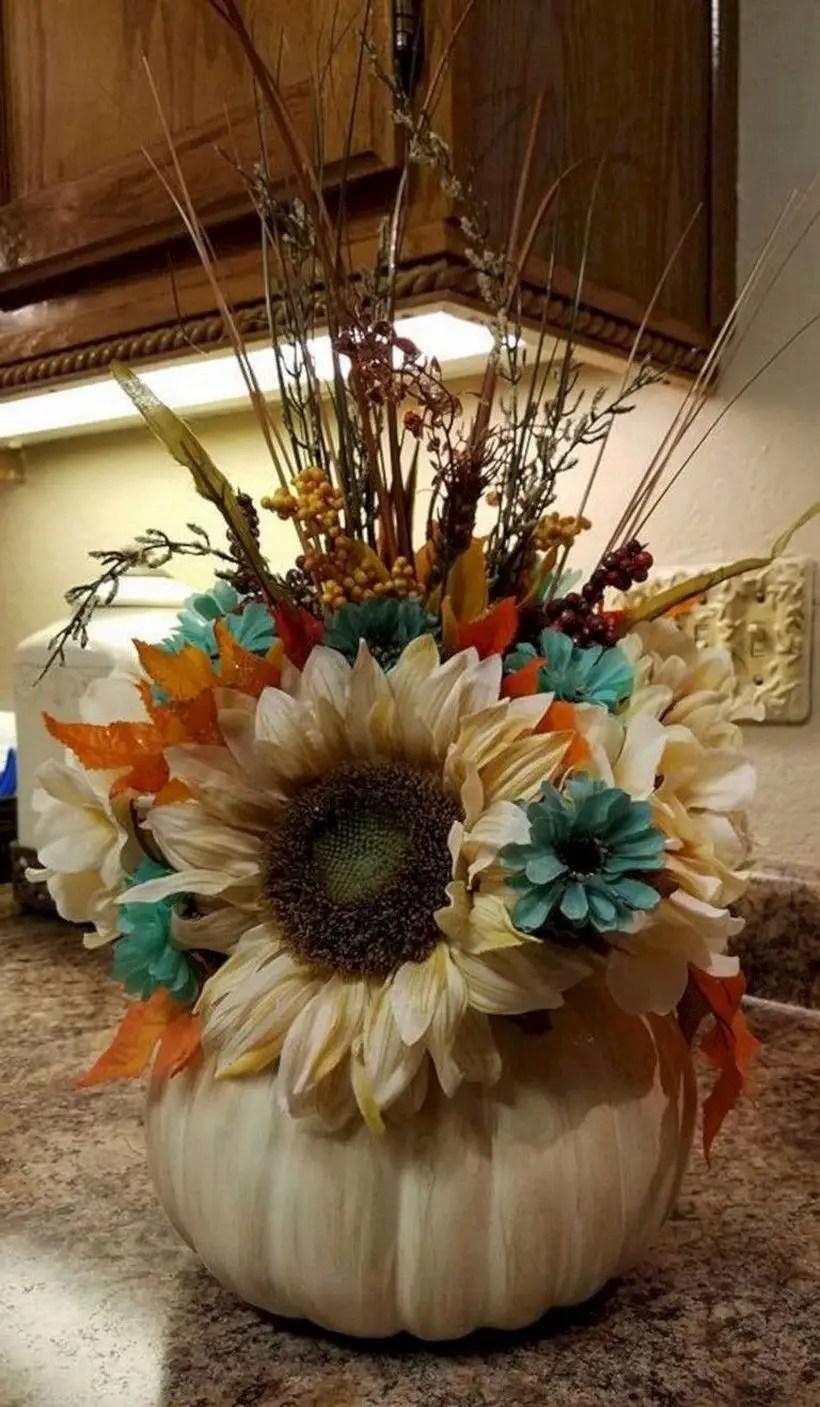 Flower arrangement using white pumpkins