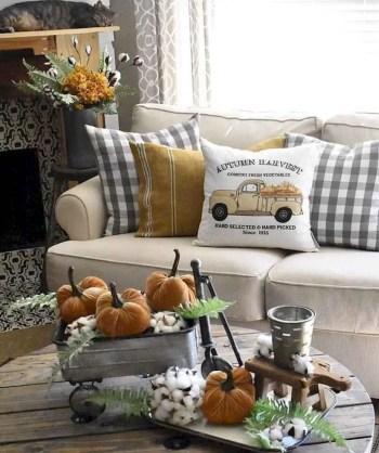 Orange pumpkin decoration on coffee table