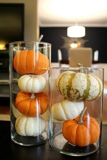 White and orange pumpkins in glass
