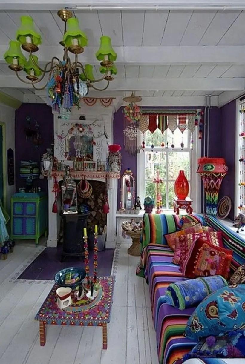 An amazing furniture for bohemian home decorating with west elm carved wood coffee table, long sofa boho, sofa cushions boho and boho chandelier.