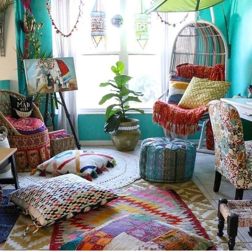 An elegant furniture for bohemian home decorating with stick rattan lounge chair, ottoman pouf cover, polyester blend small throw pillow and rug boho.