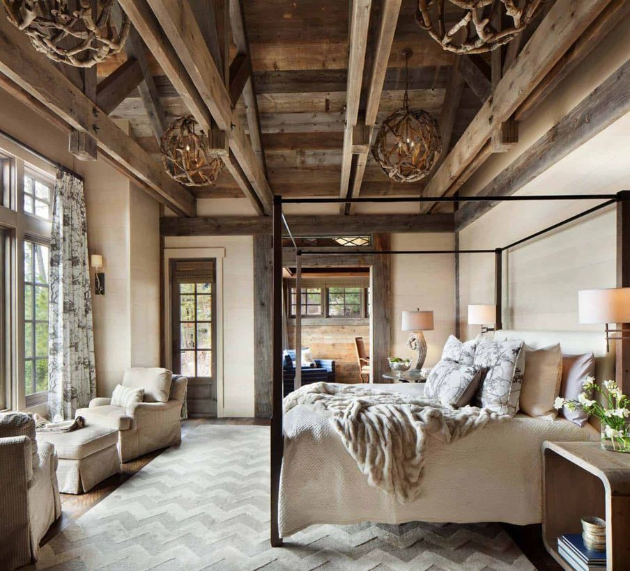 An elegant rustic chandelier for bedroom with athol 6-light globe rustic chandelier, a velvet blanket, grey chairs, a large carpet, big windows, a long curtain and wooden table.