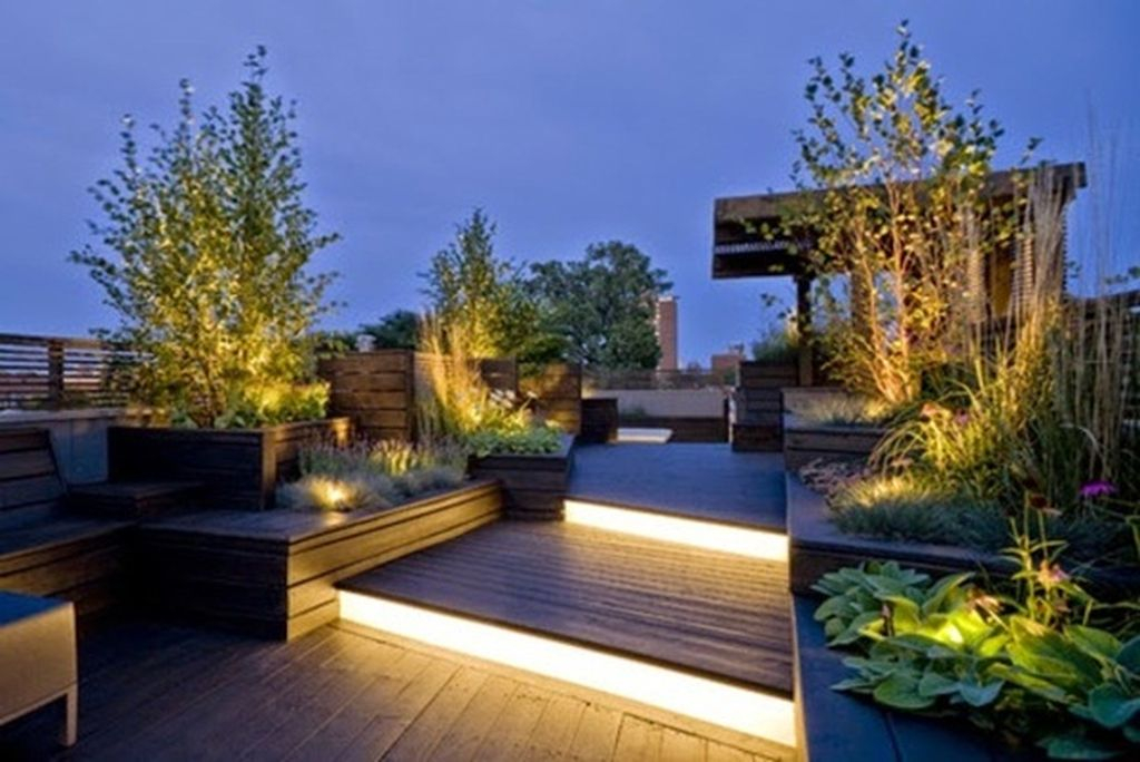 An incredible small rooftop lighting with staircase lights give a modern touch to the terrace decoration
