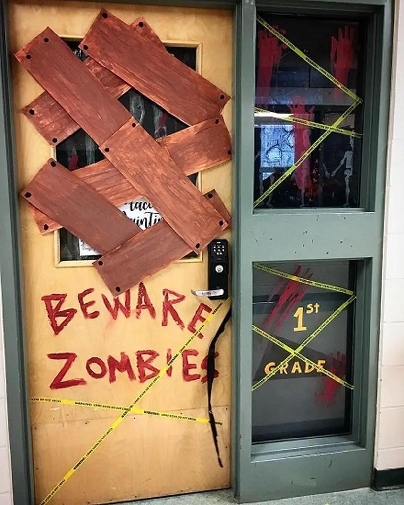 Bewere zombie halloween door.