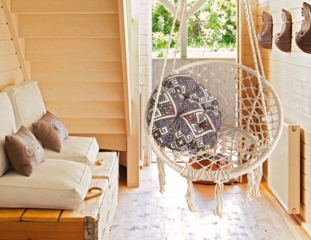 Bohemian charm into your home with a hanging macrame chair.