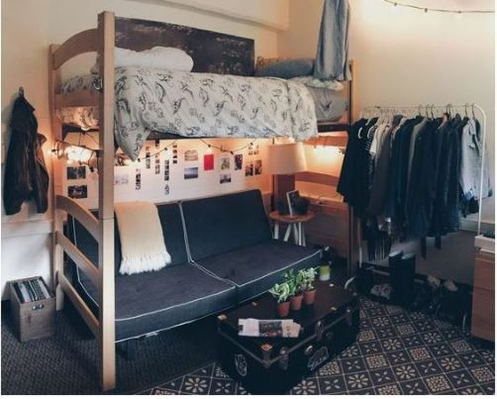 Boys room decoration with wooden bunk bed, gray mattress, patterned white blanket, white pillow, black sofa under the bed and photo decorations on the wall to look creative