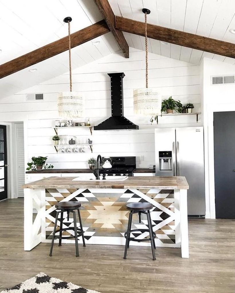 Cool boho kitchen decor with simple island patterned wooden table, hanging rattan lamps and white walls for good looking