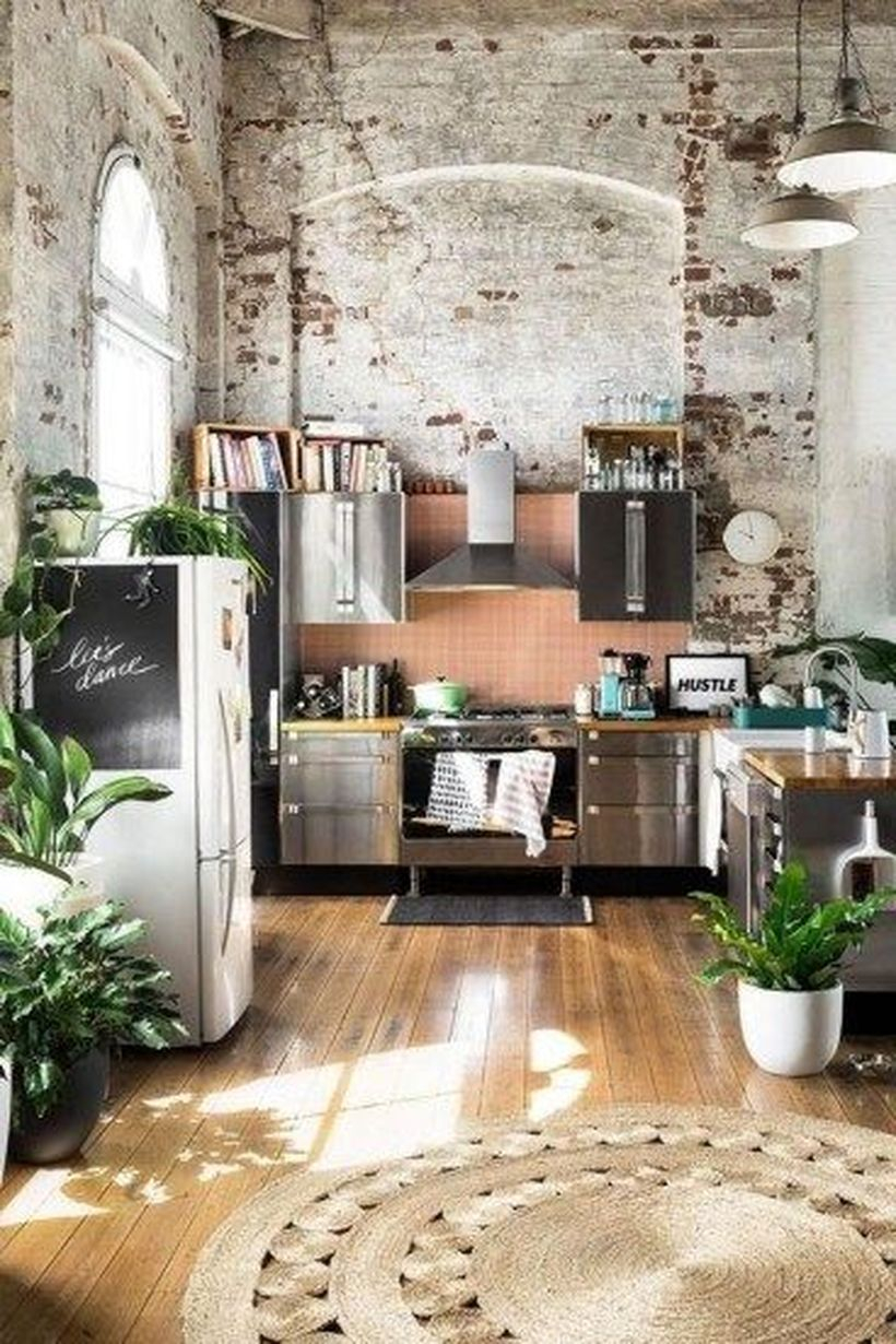 Fabulous boho kitchen decor with brown patterned circular carpet designs, wooden floors, modern, and green plants as decoration