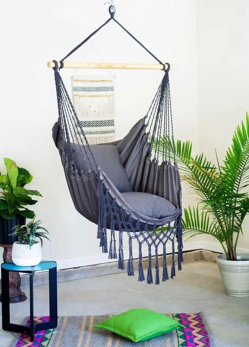 Gray macrame swing chair.