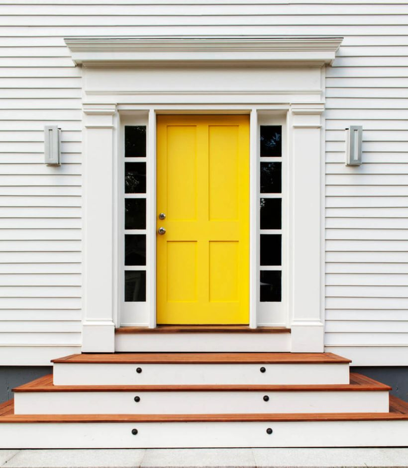 Inspired front door decoration with a vibrant yellow front door for a traditional home