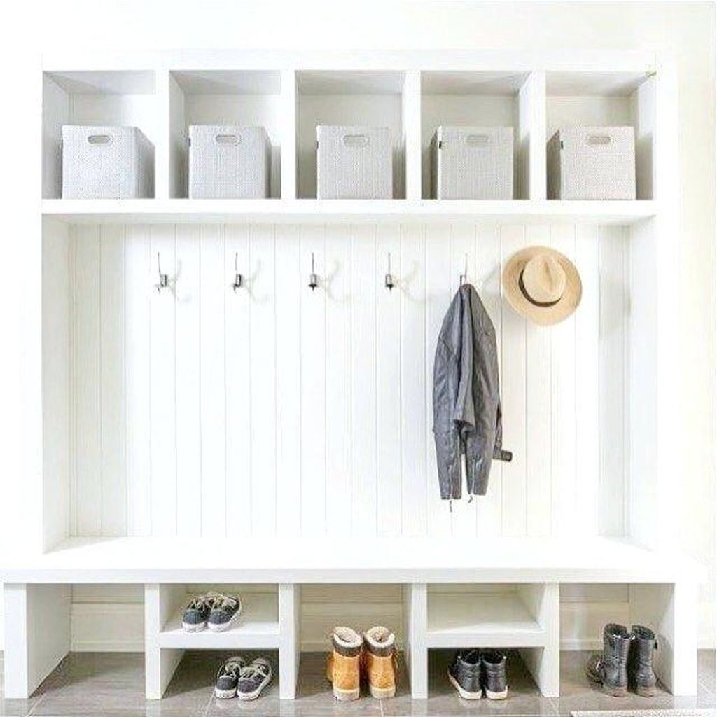 Modern entryway design with white bench combined with iron hooks below shelf medium size to keep your bag, hat and coat in your entryway