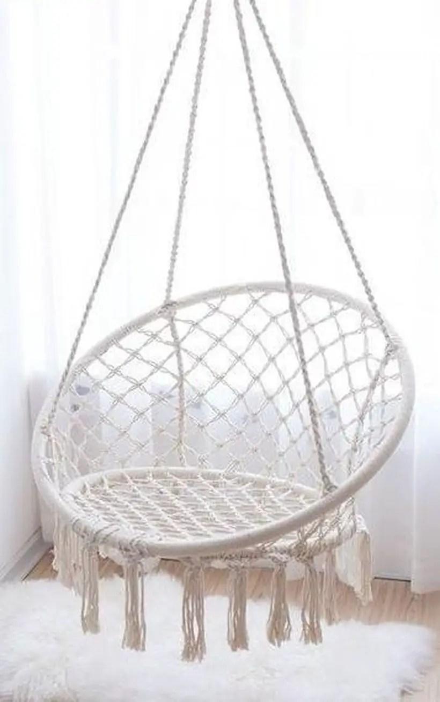 Modern hanging macrame chairs.