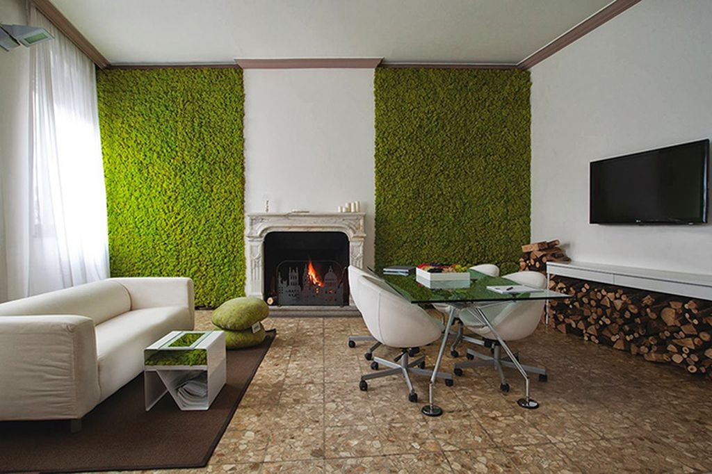 Modern living design with white sofa, granite floor and white wall combined with moss on the wall to perfect your living room design