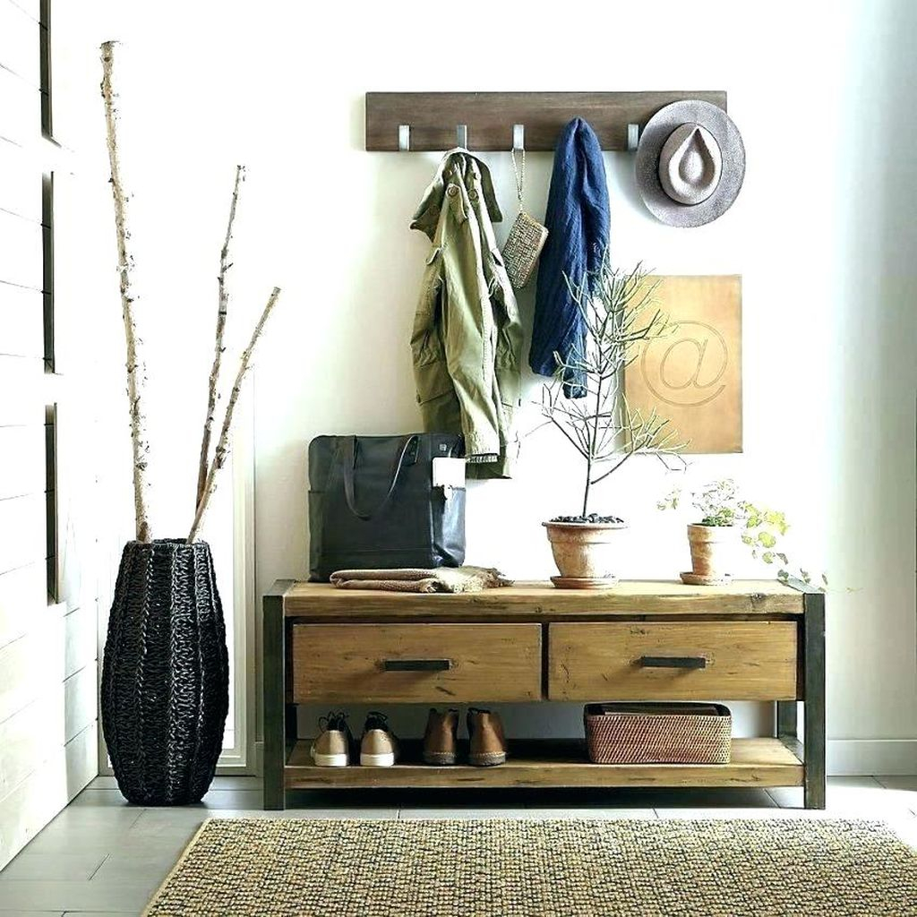 Rustic entryway with coat hooks above mudroom bench to perfect your entryway decoration