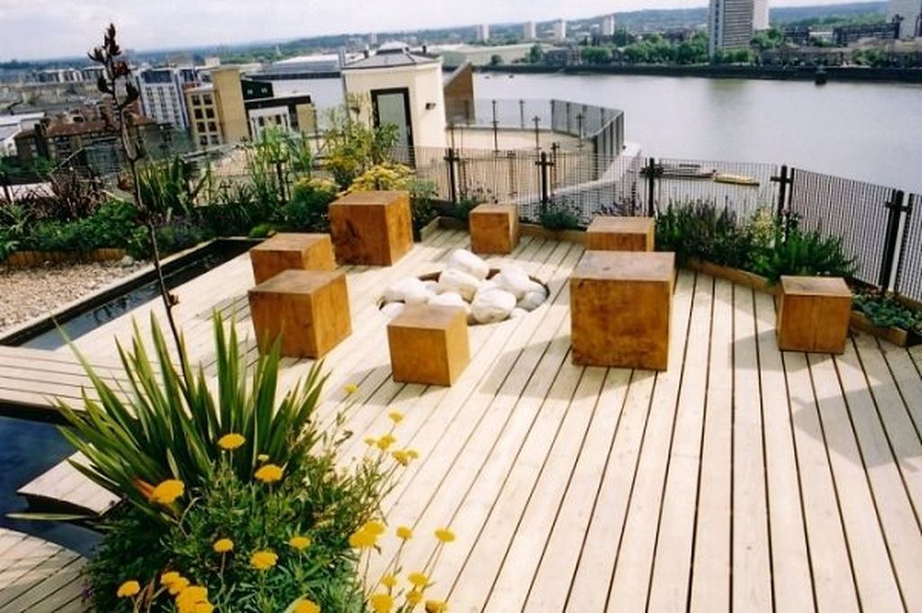 Simple rooftop garden design with wooden floor and wooden beams combined with plants around it to beautify your rooftop garden design