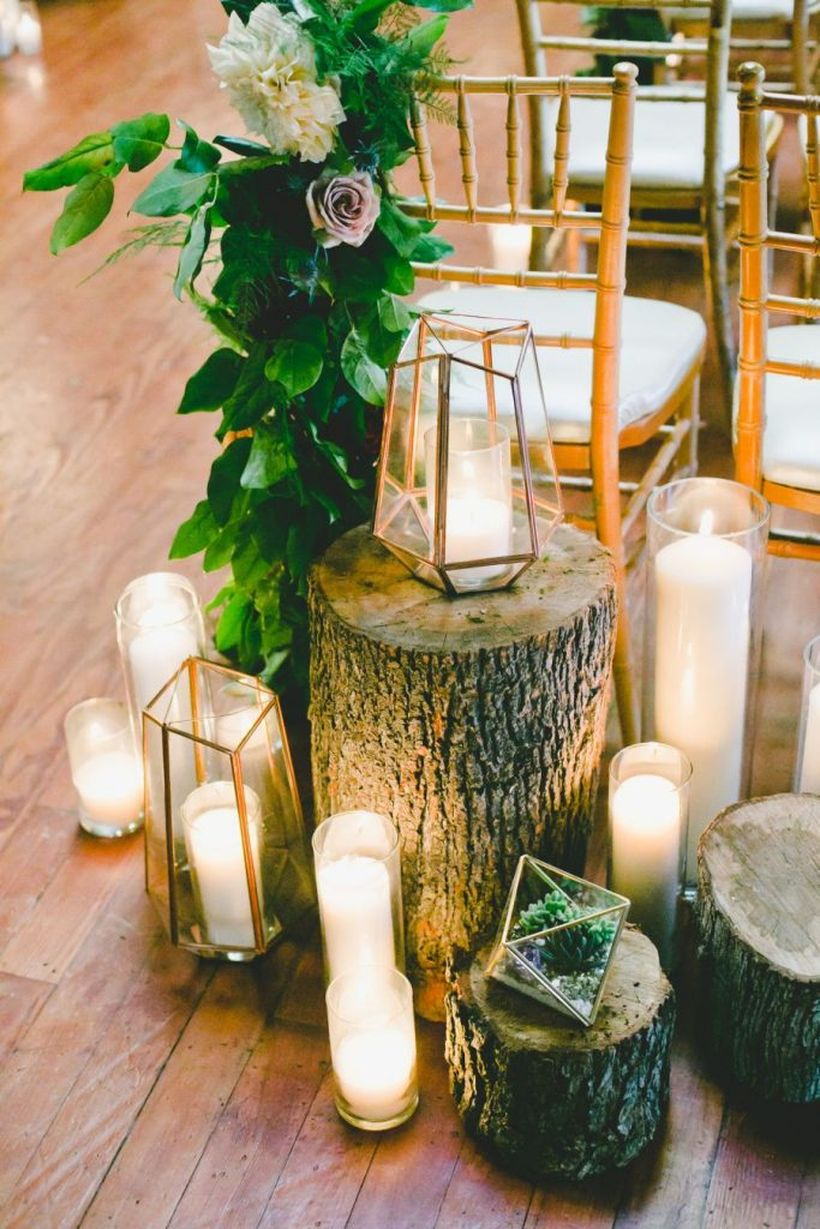 Stylish industrial geometric wedding decoration with candle holders to create a romantic atmosphere