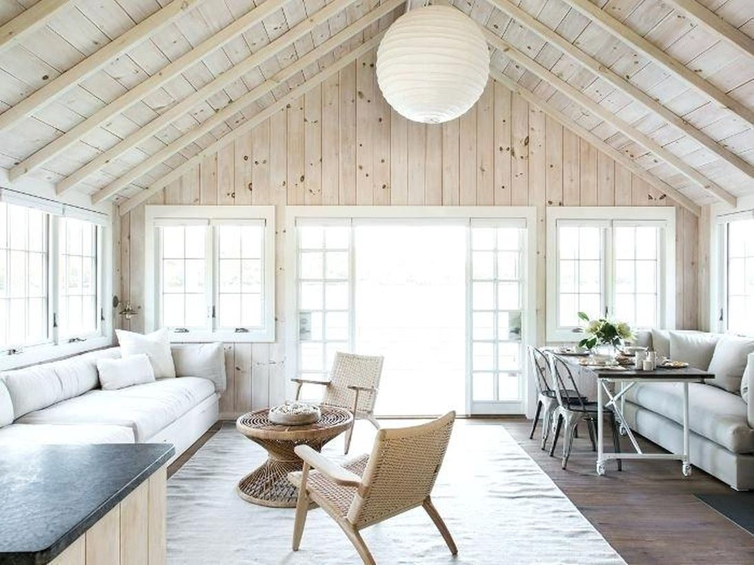 The complete interior design of a lake house transforms this very traditional southern house into a stunning lake house interior design, bringing the natural atmosphere into the house with a hardwood wall that gives you a soothing and peaceful life while indoors.