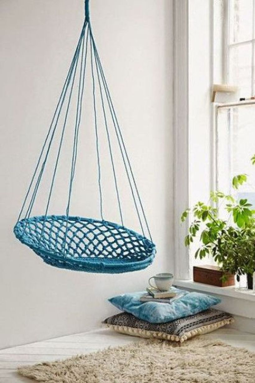 Turquoise macrame hanging chair will add color to the space.