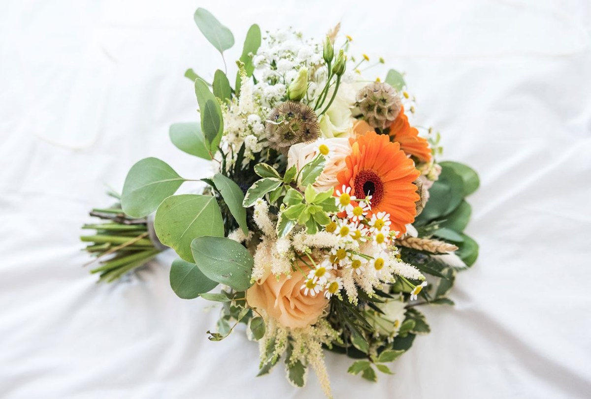 Wedding flower bouquet with beautifull flower daisy exist throughout the season to look fancy