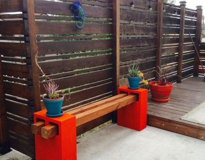 Wooden bench with red stand to perfect your garden