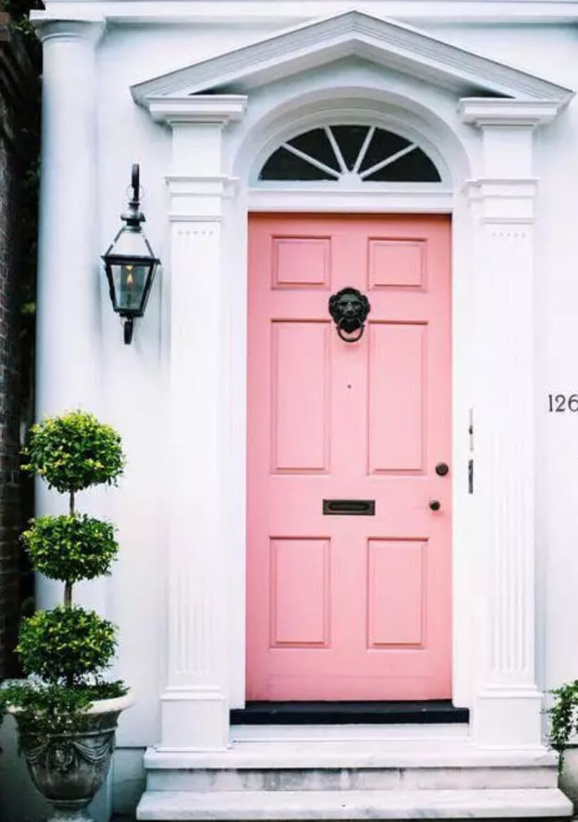 Beautiful front door decoration with a pink door to make it look cute when guests come home