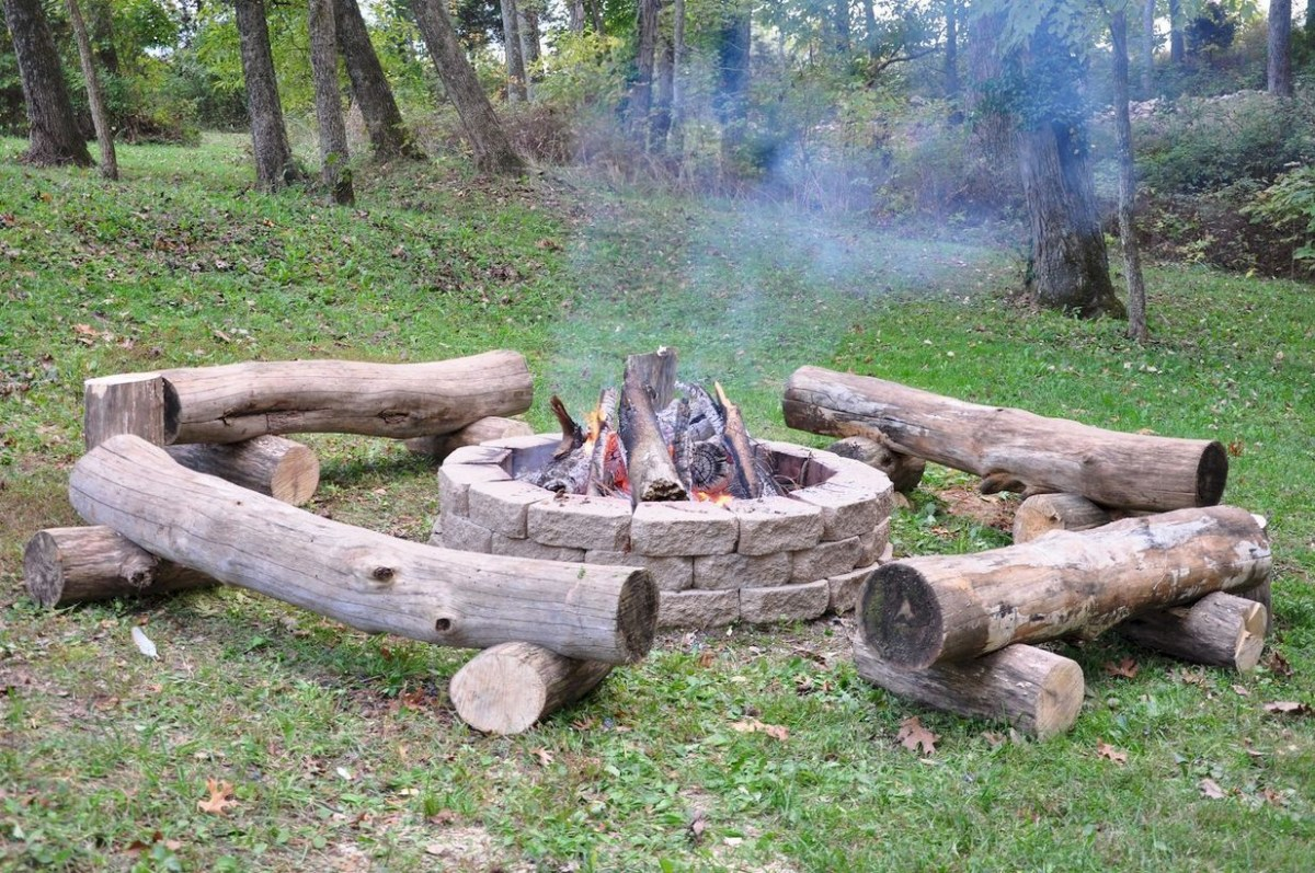 Circle fire pit with tree cut to sit